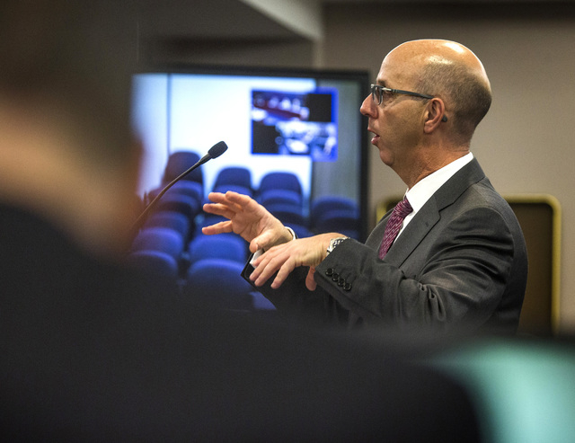 Gavin Isaacs, CEO of Scientific Games, speaks during Nevada Gaming Control Board hearing on the company's  buyout of Bally Technologies on Thursday, Nov. 20, 2014 at the Grant Sawyer Building, 555 ...