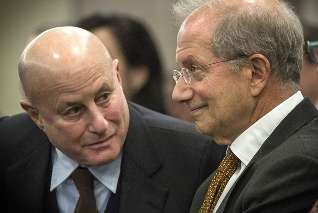 Ronald O. Perelman,left,  chairman of Scientific Games, talks to Barry F. Schwartz, Scientific Games executive vice chairman, during the Nevada Gaming Control Board hearing on the company's  buyou ...