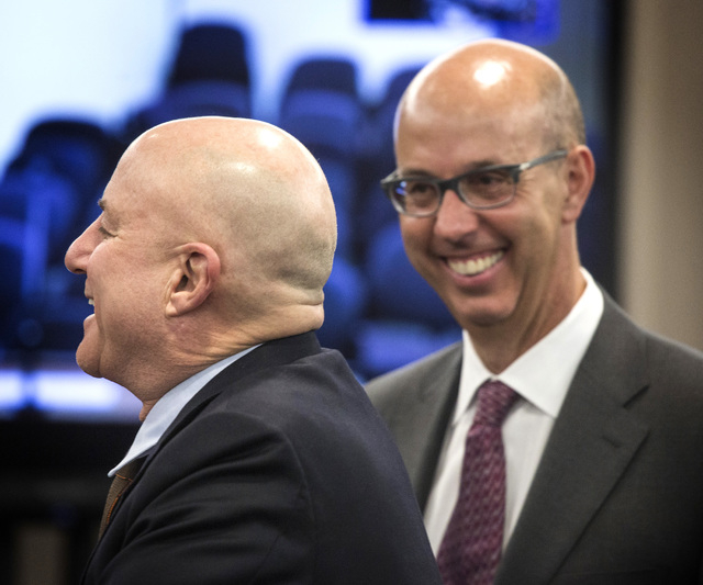 Scientific Games executives Ronald O. Perelman,left, chairman and Gavin Isaacs, CEO,  during the Nevada Gaming Commission hearing on the company's  buyout of Bally Technologies on Thursday, Nov. 2 ...