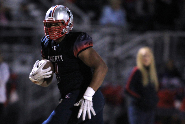 Liberty tight end Noah Jefferson heads to the end zone as he scores against Green Valley Friday, Nov. 7, 2014 at Liberty High School. Liberty won 28-14. (Sam Morris/Las Vegas Review-Journal)