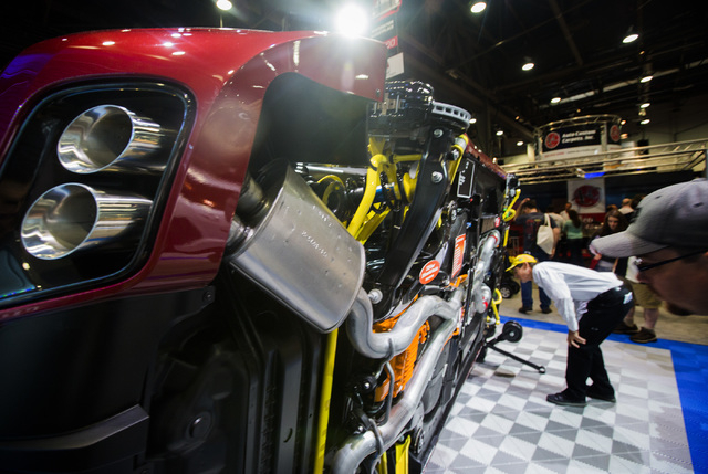 Steve Johnson views the under carriage of a Z28 Camaro in the Chevrolet booth during the Specialty Equipment Market Association Show at the Las Vegas Convention Center on Tuesday, Nov.4,2014.  Aro ...