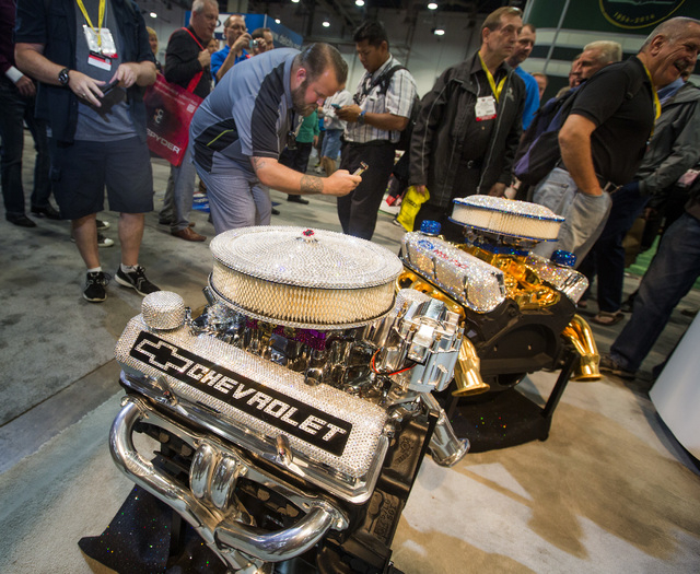 Matt Barton takes a photo sequin engine blocks in the Proform booth during the Specialty Equipment Market Association Show at the Las Vegas Convention Center on Tuesday, Nov.4,2014. Around 60,000  ...