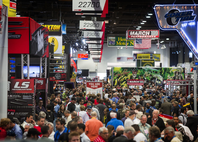 A crowd of people during  the Specialty Equipment Market Association Show at the Las Vegas Convention Center on Tuesday, Nov.4,2014. Around 60,000 people are estimated to attend the  four-day trad ...