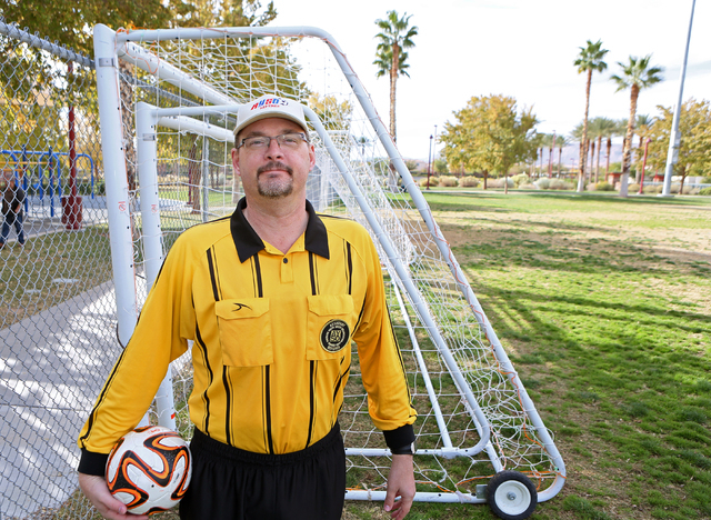 Father of two Dave High, 50, stands near a soccer goal at Summerlin's Community Park Nov. 19. High, a youth soccer referee, is grateful this Thanksgiving to have survived a heart attack Sept. 6. ...