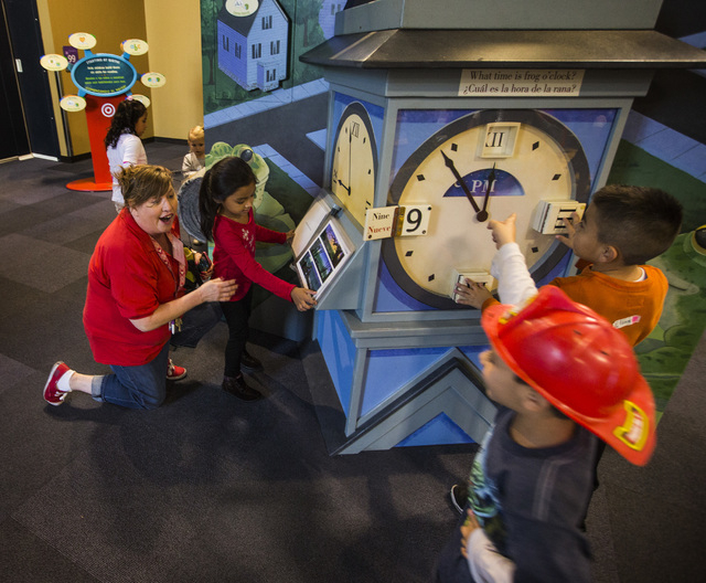 "Colleen Poole, left,kindergarten teacher at Elaine Wynn Elementary School interacts with the students at The ""Storyland: A Trip Through Childhood Favorites,"" exhibit   at the Discovery M ..."