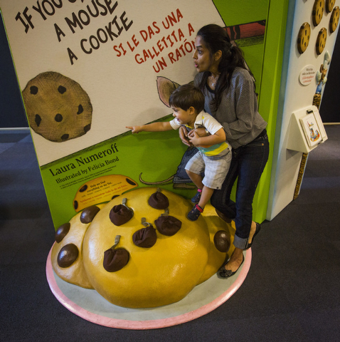 "Roxana Mendel, right, holds her nephew Aiden Hoss, 2 1/2, while visiting The ""Storyland: A Trip Through Childhood Favorites,"" exhibit at the Discovery Museum,360 Promenade Place, on Frid ..."