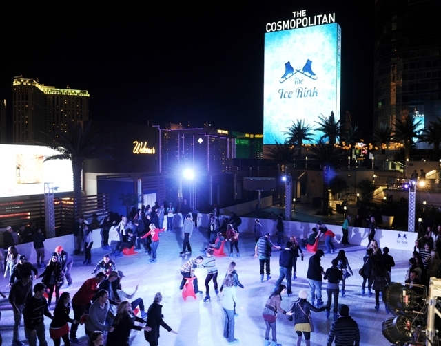 From snowfall to S'mores to skating, The Ice Rink at The Cosmopolitan of Las Vegas provides a winter wonderland -- with a Strip view. Photo credit: Denise Truscello. Courtesy photo.