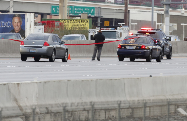 Nevada Highway Patrol at the scene where troopers involved in a shooting dead of a man carrying a Ҩigh-power rifleӠwhile walking Interstate 15 on Saturday, Nov. 1, 2014. The 15 was shu ...