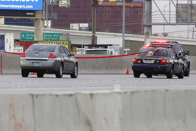 """Nevada Highway Patrol at the scene where troopers involved in a shooting dead of a man carrying a """"high-power rifle"""" while walking Interstate 15 on Saturday, Nov. 1, 2014. The 15 was ..."""