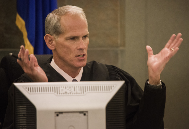 Judge Douglas Herndon speaks during the temporary-restraining-order hearing on Uber at Regional Justice Center on Wednesday, Oct. 29, 2014. Herndon denied the TRO against the ride-sharing company. ...
