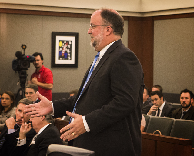 Senior Deputy Attorney General David Newton speaks during a hearing on Uber at the Regional Justice Center on Wednesday, Oct. 29, 2014. Judge Douglas Herndon denied a temporary restraining order a ...
