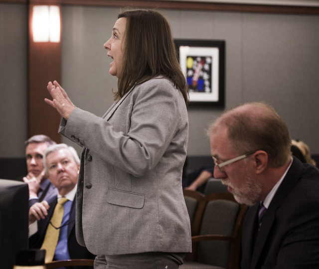 Senior Deputy Attorney General Kimberly Arguello  speaks during a hearing on ride-sharing company Uber on Monday, Nov.17, 2014 at Regional Justice Center. District Court Judge Doug scolded the sta ...