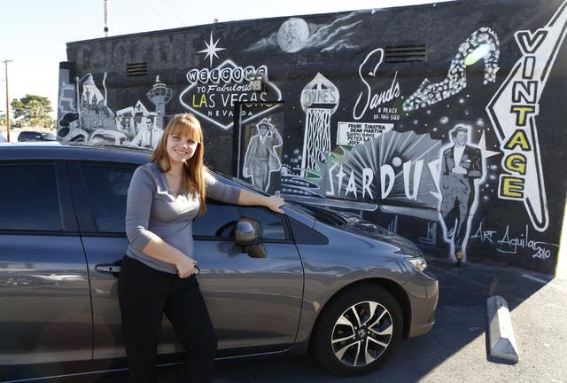 "Uber driver Maria Nekljudova of Las Vegas poses for photo near Las Vegas mural at 1441 Las Vegas Blvd. South on Thursday, Oct.  23, 2014, near the ""Welcome to Downtown Las Vegas"" sign. (Bizuayehu  ..."