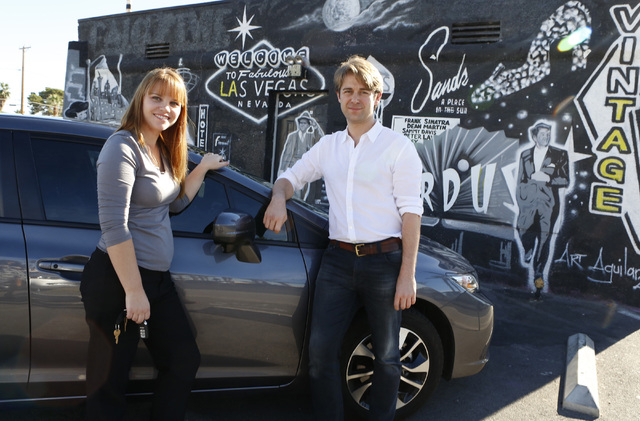 William Barnes, Uber's western operations manager, right, and Uber driver Maria Nekljudova of Las Vegas pose for photo near historic Las Vegas mural at 1441 Las Vegas Blvd. South on Thursday, Oct. ...