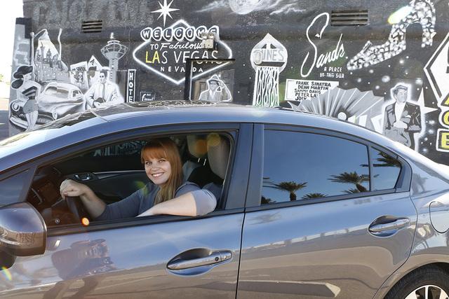 "Uber driver Maria Nekljudova of Las Vegas poses for photo near historic Las Vegas mural at 1441 South Las Vegas Boulevard  on Thursday, Oct.  23, 2014, near The ""Welcome to Downtown Las Vegas"" sig ..."