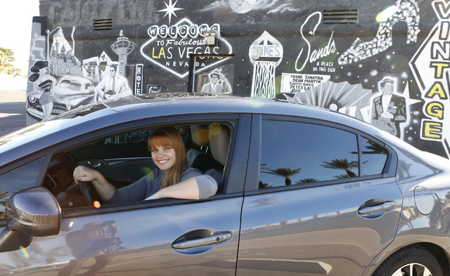 "Uber driver Maria Nekljudova of Las Vegas poses for photo near historic Las Vegas mural at 1441 South Las Vegas Boulevard  on Thursday, Oct.  23, 2014, near The ""Welcome to Downtown Las Vegas"" sig ..."