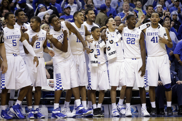 The Kentucky team watches from the sideline late in the second half of an NCAA college basketball game against Kansas, Tuesday, Nov. 18, 2014, in Indianapolis. Kentucky won 72-40. (AP Photo/Darron ...
