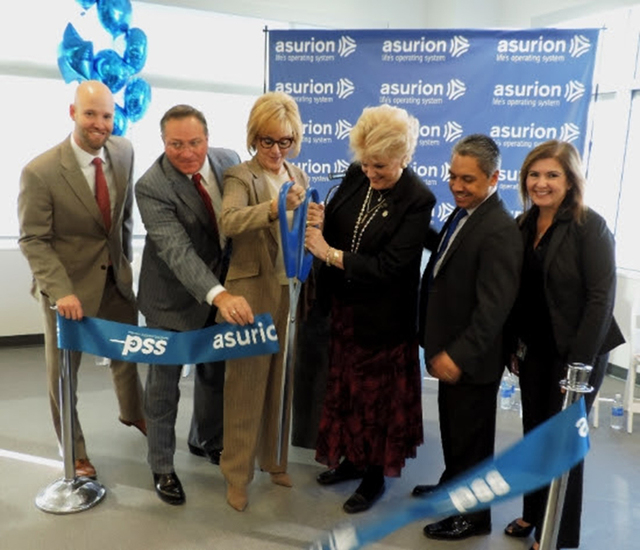 Councilman Steve Ross, second to left, participates in a ribbon cutting with members of Asurion, a global leader in technology protection services, for the new Las Vegas Premier Support Solutions  ...