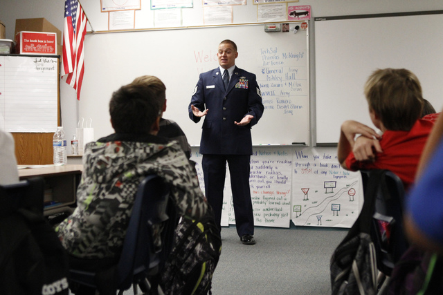 U.S. Air Force Tech Sgt. Thomas McKnight speaks to a fifth grade class at Doris French Elementary School in Las Vegas Friday, Nov. 7, 2014. Veterans from a variety of wars have visited the element ...