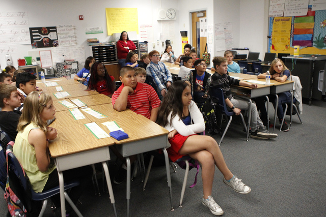 Fifth grade students at Doris French Elementary School in Las Vegas listen to a presentation by U.S. Air Force Tech Sgt. Thomas McKnight speak about his military experience Friday, Nov. 7, 2014. V ...