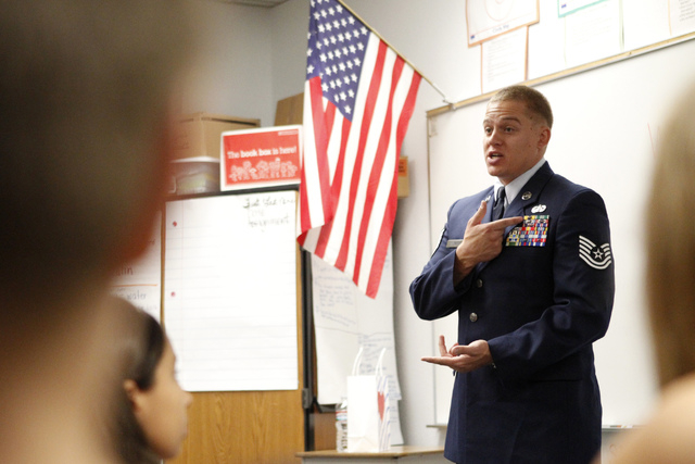 U.S. Air Force Tech Sgt. Thomas McKnight explains his military ribbons to a fifth grade class at Doris French Elementary School in Las Vegas Friday, Nov. 7, 2014. Veterans from a variety of wars h ...