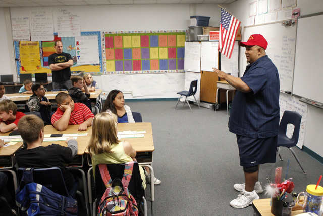 U.S. Marines Veteran Sgt. James Romero gives a presentation on his military experience to a fifth grade class at Doris French Elementary School in Las Vegas Friday, Nov. 7, 2014. Veterans from a v ...