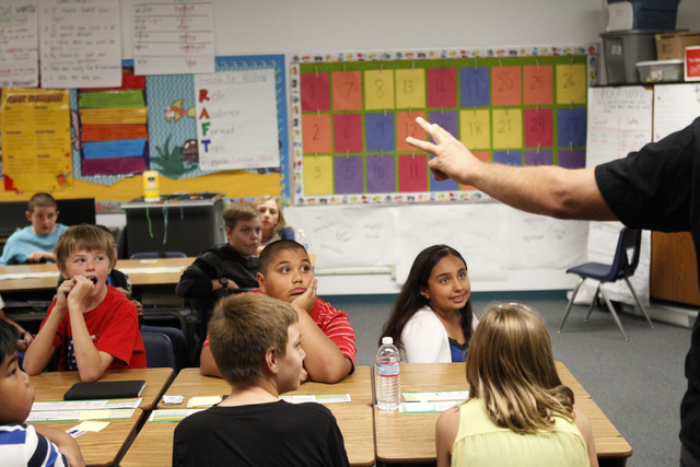 Fifth grade students at Doris French Elementary School in Las Vegas listen to a presentation by U.S. Army Veteran Spc. Salvatore Cirifalco during their class Friday, Nov. 7, 2014. Veterans from a  ...