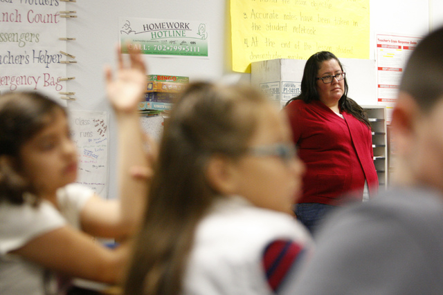 Fifth grade teacher Celia Roberts listens to a presentation by U.S. Air Force Tech Sgt. Thomas McKnight on his military experience during her class at Doris French Elementary School in Las Vegas F ...