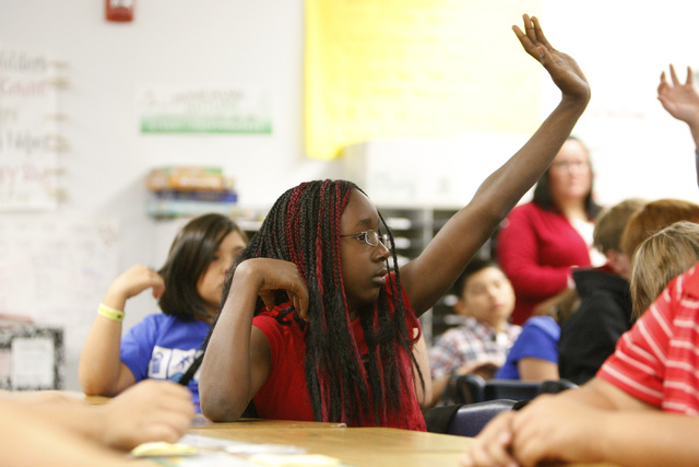 Fifth grade student Victoria Dotson, 10, raises her hand to ask a question during a presentation by U.S. Air Force Tech Sgt. Thomas McKnight in her class at Doris French Elementary School in Las V ...