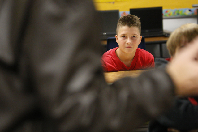 Fifth grade student Andrew Hall, 10, listens to his grandfather U.S. Army Veteran Gen. Ashley Hall speak to his class about his military experience at Doris French Elementary School in Las Vegas F ...