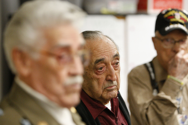 World War II U.S. Army Veteran Pfc. Nono Zicari, center, listens for questions during his presentation on his military experience to a fifth grade class at Doris French Elementary School in Las Ve ...