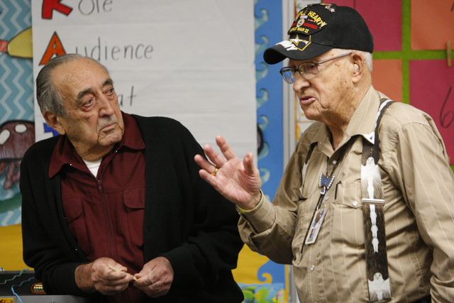 World War II U.S. Army Veterans Pfc. Nono Zicari, left, listens to Paratrooper Robert Mueller speak on his military experience to a fifth grade class at Doris French Elementary School in Las Vegas ...