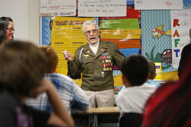 World War II Veteran U.S. Army Tech 5th grade Milton Duran speaks about his military experience to a fifth grade class at Doris French Elementary School in Las Vegas Friday, Nov. 7, 2014. Veterans ...