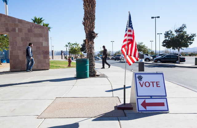 People arrive and leave the polling place at Desert Breeze Community Center in Las Vegas on Tuesday, Nov. 4, 2014. (Chase Stevens/Las Vegas Review-Journal)