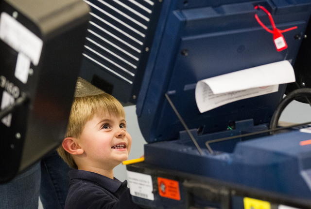 Two-year-old Jackson Ungaro watches as his mother, Rachel, votes at Desert Breeze Community Center in Las Vegas on Tuesday, Nov. 4, 2014. (Chase Stevens/Las Vegas Review-Journal)