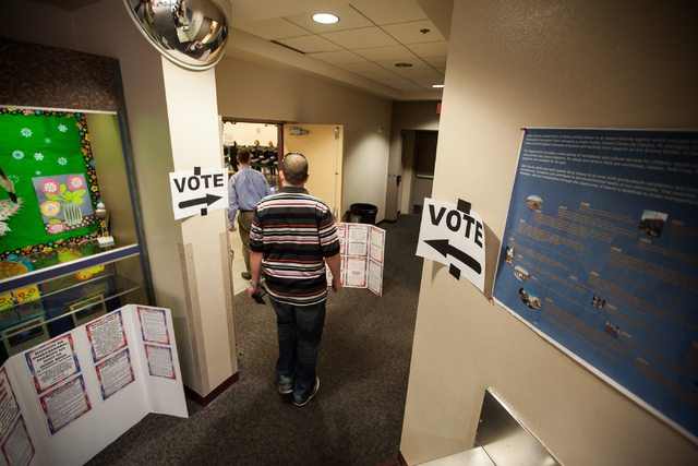 People arrive to vote at Desert Breeze Community Center in Las Vegas on Tuesday, Nov. 4, 2014. (Chase Stevens/Las Vegas Review-Journal)