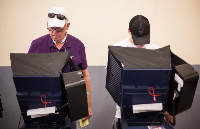 Wayne Bailey, left, and David Wong vote at Desert Breeze Community Center in Las Vegas on Tuesday, Nov. 4, 2014. (Chase Stevens/Las Vegas Review-Journal)