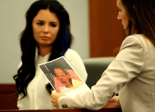 Chief Deputy District Attorney Jacqueline Bluth shows Christy Mack photos of Mack that were taken after she was allegedly battered by ex-boyfriend Jonathan Koppenhaver, aka War Machine, during a p ...