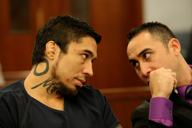 Jonathan Koppenhaver, aka War Machine, consults with defense attorney Brandon Sua during a preliminary trial hearing at the Las Vegas Regional Justice Center on Friday November 14, 2014. (Michael  ...