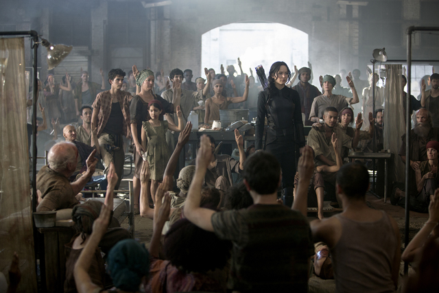 """Jennifer Lawrence stars as Katniss Everdeen in """"The Hunger Games: Mockingjay -- Part 1."""" (Murray Close/Lionsgate)"""