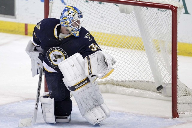 St. Louis Blues goalie Jake Allen (34) allows the only goal of the shootout, scored by Ottawa Senators' Bobby Ryan (6), in a NHL hockey game, Tuesday, Nov. 25, 2014 in St. Louis. The Senators beat ...
