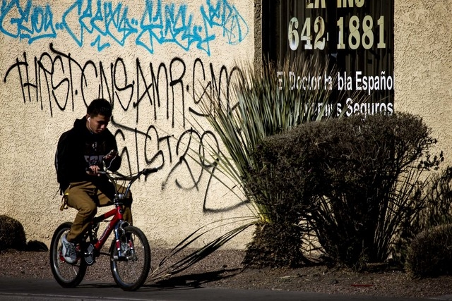 Graffiti as is seen Wednesday, Nov. 26, 2014 at 2630 E. Lake Mead, North Las Vegas. North Las Vegas Councilman Isaac Barron is proposing a $.50 fee increase to clean up graffiti in the city. (Jeff ...