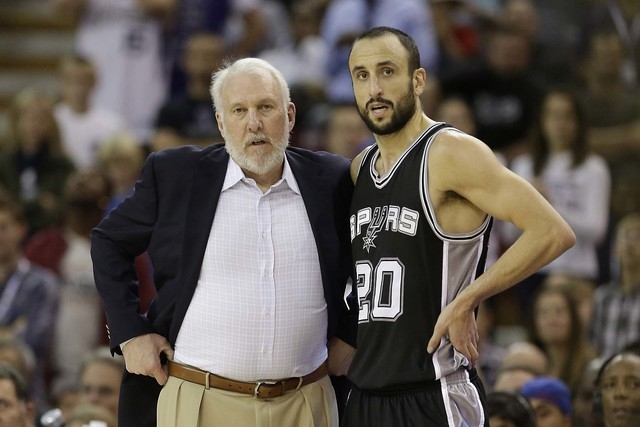 In this Nov. 15, 2014, file photo, San Antonio Spurs head coach Gregg Popovich talks with Spurs guard Manu Ginobili during the second half of an NBA basketball game against the Sacramento Kings in ...