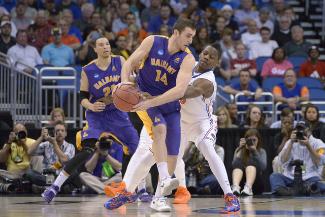 Albany forward Sam Rowley is shown in an NCAA Tournament game against Florida in March. Rowley is averaging 11 points and 8.5 rebounds per game this season. (AP Photo/Phelan M. Ebenhack)