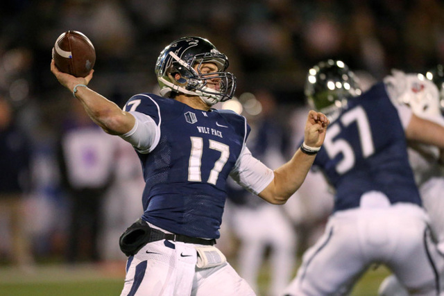 UNR quarterback Cody Fajardo has completed 60.6 percent of his passes for 2,328 yards and 15 touchdowns. He also leads the Wolf Pack with 854 yards and 12 TDs rushing. (AP Photo/Cathleen Allison)