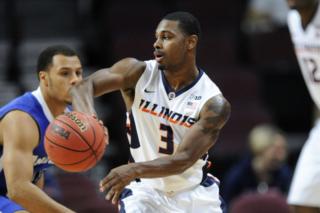University of Illinois Fighting Illini guard Ahmad Starks (3) passes the ball against the Indian State Sycamores during the Las Vegas Invitational NCAA Basketball tournament at Orleans Arena in La ...