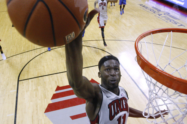 UNLV forward Goodluck Okonoboh blocks a shot by Morehead guard Kareem Storey during the Rebels home opener Friday, Nov. 14, 2014 at the Thomas & Mack Center. UNLV won 60-59. (Sam Morris/Las Vegas  ...