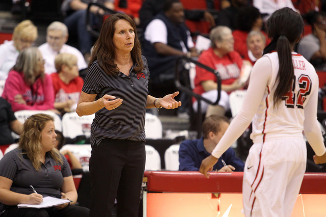 UNLV womens basketball coach Kathy Olivier gives instruction to senior guard Danielle Miller (42) as the Lady Rebels take on Dixie State in an exhibition game at the Cox Pavilion Monday, Nov. 10,  ...