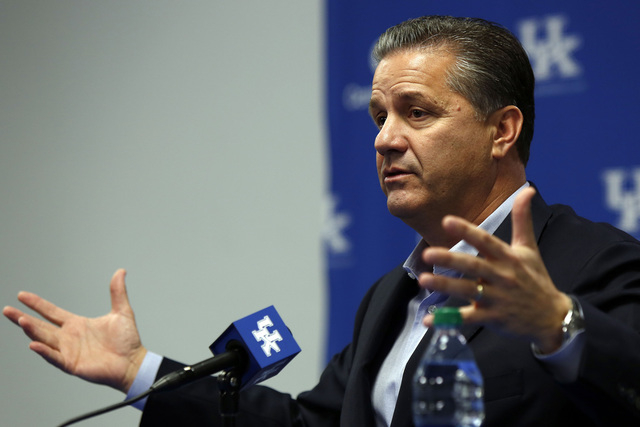 Kentucky coach John Calipari has a team that many think could finish undefeated, but the Wildcats' schedule won't be easy. (AP Photo/James Crisp)