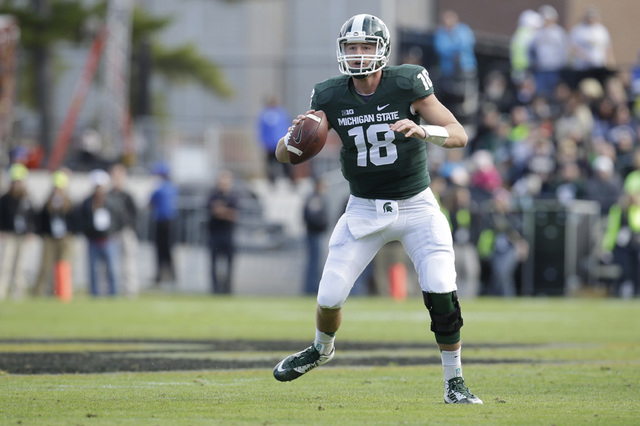 Michigan State quarterback Connor Cook (18) as Michigan State played Purdue in an NCAA college football game in West Lafayette, Ind., Saturday, Oct. 11, 2014. Michigan State won 45-31. (AP Photo/A ...